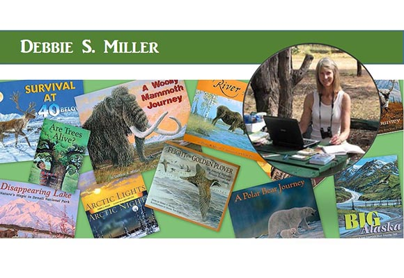 Debbie Miller with a bunch of her books.
